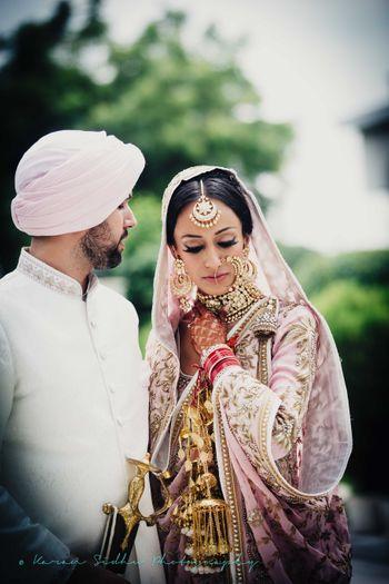 Pstel pink sikh bride