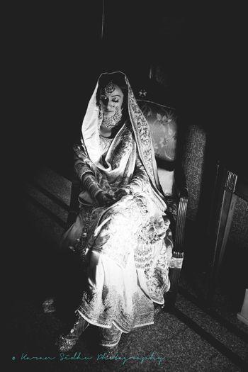 Black and White Timeless Sitting Sikh Bride Portrait