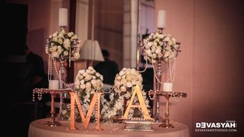 Table Decor with Monograms and Florals and Fairy Lights