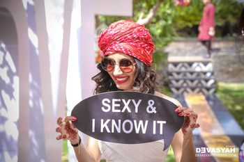 Fun Bridesmaid Photo Wearing Turban and Message Board