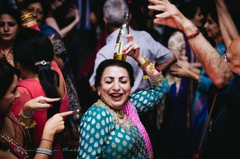 Mother of the Bride Dancing with Bottle on the Head