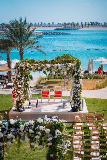 Photo of beachside floral mandap idea for an intimate wedding