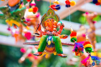 Colourful Mehendi Decor with Ganeshji and Pompoms