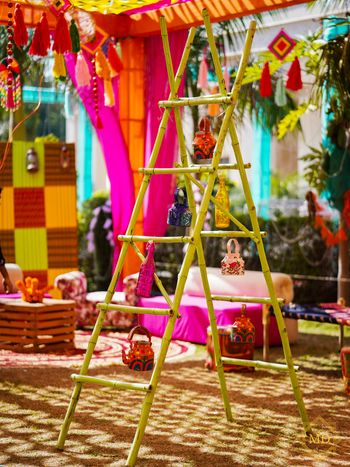 Ladder decorated with kettles, glass bottles and more for mehndi photobooth