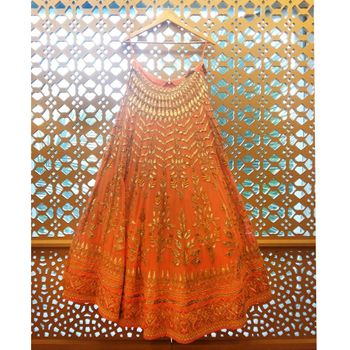 Photo of orange gota patti bridal lehenga