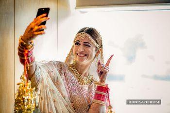 wedding day bridal portrait taking a selfie