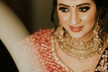 gold and brown bridal look with bold brows