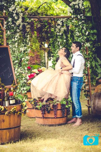 Couple Stomping Grapes in Vineyard Theme Shoot