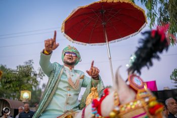 groom entering on horse during his baraat