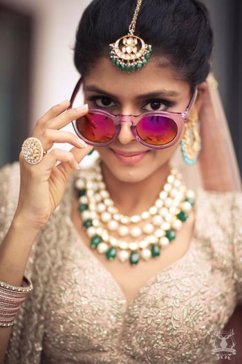 Fun Bridal Photo with Sunglasses and Contrasting Jewels