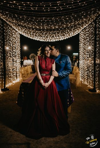 A cute couple portrait with fairy lights in the backdrop.