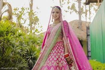 bright pink lehenga with contrasting green dupatta