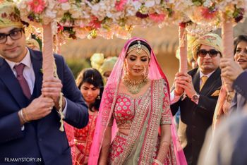 Photo of bridal entry portrait with bride matching chadar