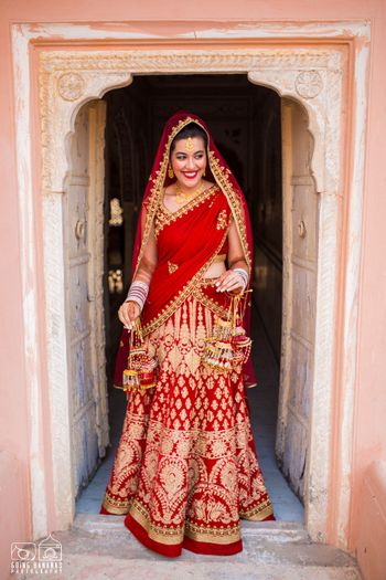 Bride Entering in Bright Red and Gold Bridal Lehenga