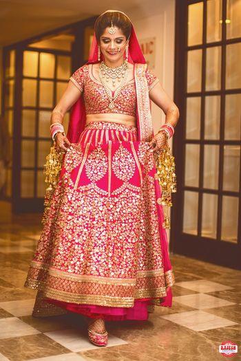 Fuschia pink and gold bridal lehenga