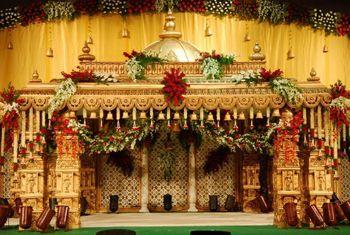 Grand mandap decor for a South Indian wedding.
