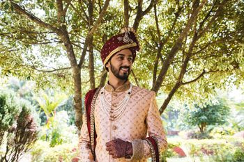 light pink and maroon groom sherwani