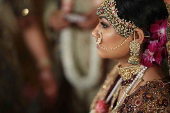 heavy bridal jewellery with maroon lehenga