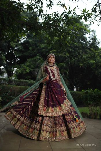 unique bridal lehenga in maroon with green dupatta