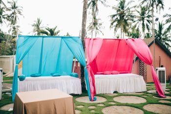 Colourful draped seatings for guests.