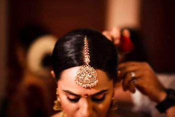 A vintage maang tikka for South Indian brides.