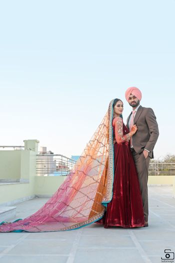 A Sikh couple posing on their engagement ceremony