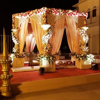 A beautifully draped mandap with floral arrangements