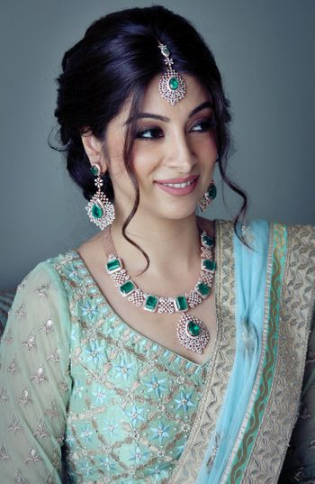 Emerald and Diamond Jewellery with Aqua Lehenga