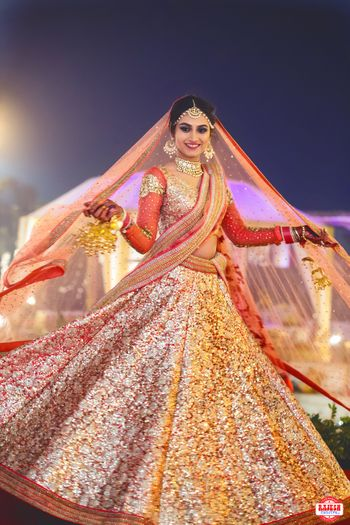 Bride Wearing Gold Sequin Work Lehenga with Red Blouse