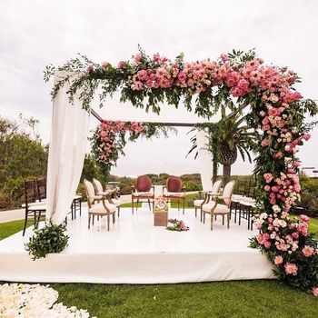 A gorgeous pink floral mandap by the seaside.