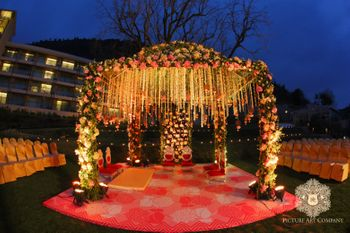 Colourful Floral Arrangementand Lighting for Mandap