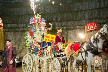 Photo of Dramatic Groom Entry on Carriage with Fireworks