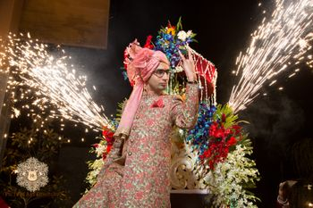 Photo of Groom Entering with Cart and Fireworks