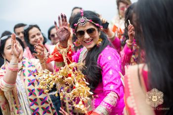 Bride Dancing with Kaleeras on Mehendi wearing Sunnies