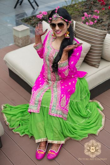Photo of Bright Pink and Green Kurta and Lehenga for Mehendi