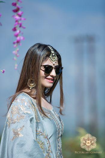 Photo of Bride in Mehendi Function Wearing Sunglasses
