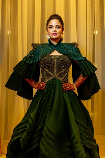 Bride in a structured green gown