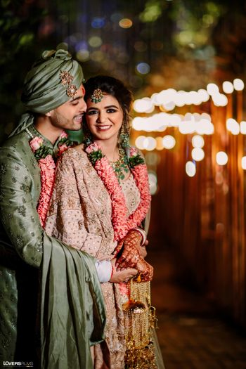 Photo of pretty bride and groom shot with groom in grey sherwani
