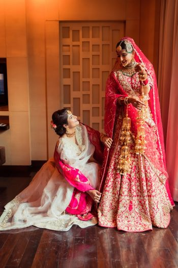 Bride with her sister, getting ready for her wedding