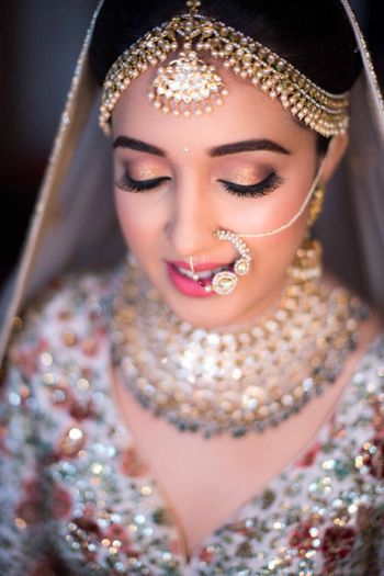 Bride with bold brows and gold eye makeup
