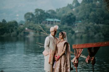 matching pastel bride and groom post wedding outdoor shoot next to boat