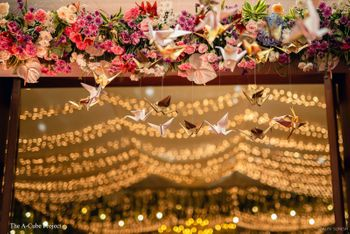 Paper cranes in wedding decor.
