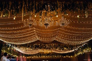 Fairy lights used in ceiling decor.
