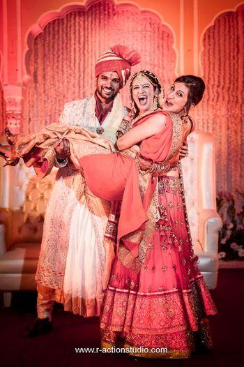 Bride Picking up Sister During Wedding