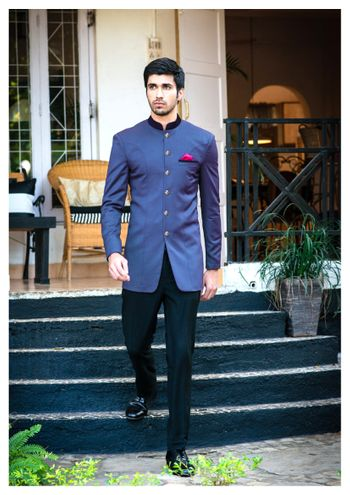 blue bandhgala with high neck and jodhpur trousers