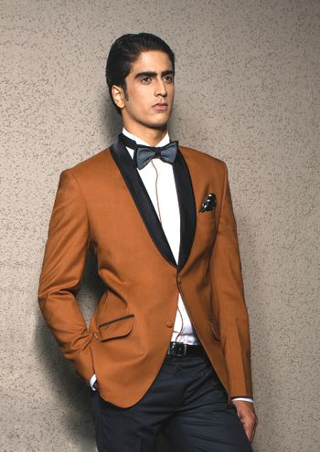Photo of brown tux with black lapels and bow tie