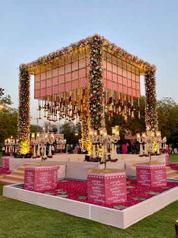 Pretty pink floral mandap decor