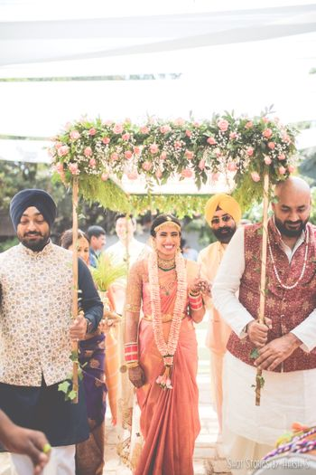 Photo of South Indian bride entering under phoolon ki chadar