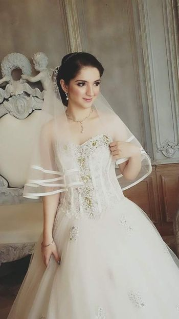 Photo of Bride in Christian Bridal Gown with Stone Work
