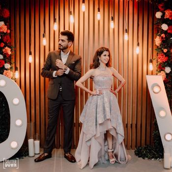 sangeet photobooth decor idea with couple posing